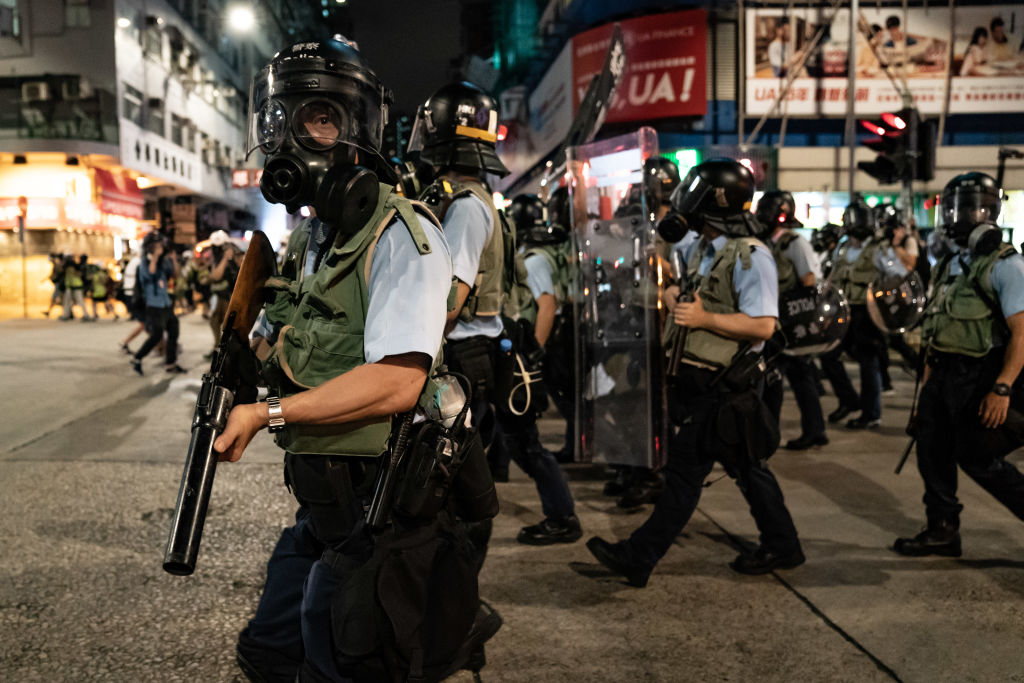 Police charge on a street during a demonstration on Hungry Ghost Festival day in Sham Shui Po district on August 14, 2019 in Hong Kong, China.