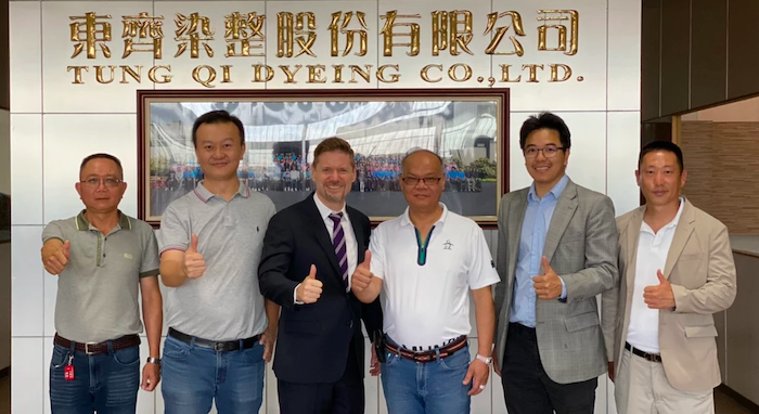 Ed Shim (second from left) and his partners in Taiwan.
